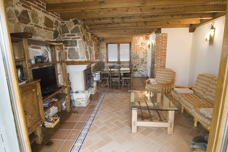 wood heating: Living room with fireplace in a country cottage.