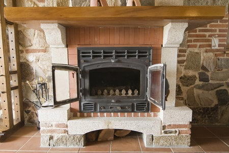 Fireplace in a cottages living room. photo