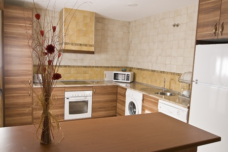 Kitchen decorated with a bouquet. photo