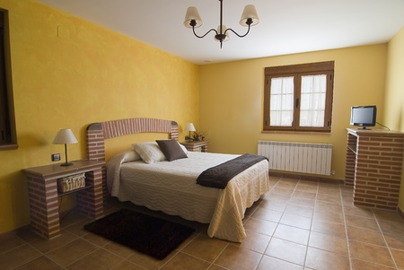 bedchamber: Bedroom decorated with bricks. Stock Photo