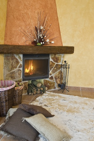 Detail of the fireplace in the living room. Stock Photo