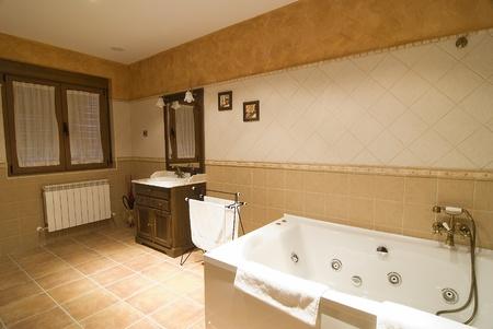 hygienics: A bathroom with a whirlpool tub.
