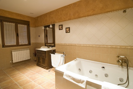A bathroom with a whirlpool tub.