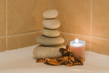 Some stones in zen balance and a candle in the bathroom. Stock Photo - 9159166