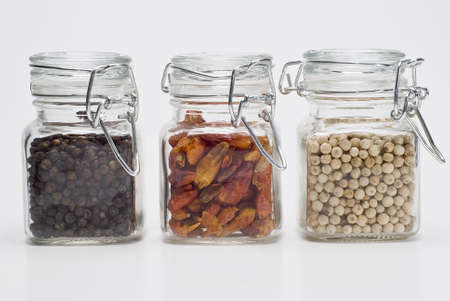Spicy spices into glass jars. photo
