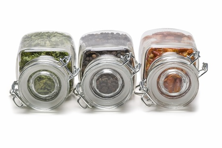 Some spice jars isolated over white. photo