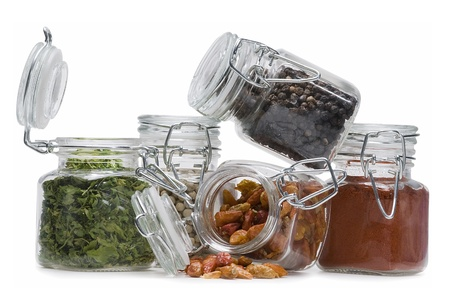 Some jars with spices isolated on a white background. photo