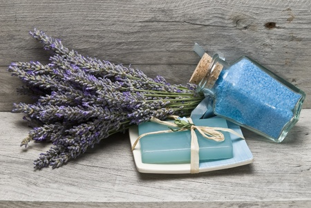 old items: Lavender and some hygiene items made of lavender on an old wooden shelf.