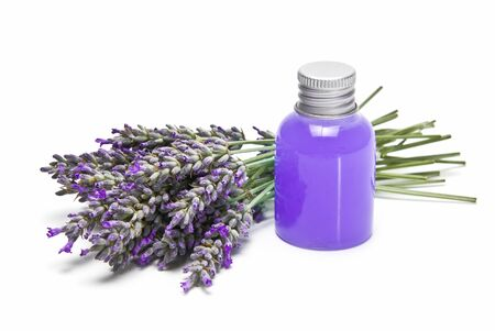 A jar of gel and a bunch of lavender isolated over a white background. photo