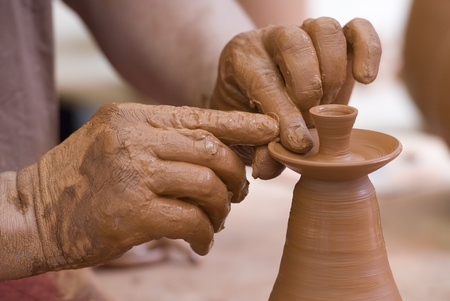 clay craft: Potter working with clay. Stock Photo