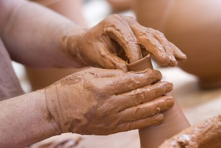 clay pot: Potter working with clay. Stock Photo