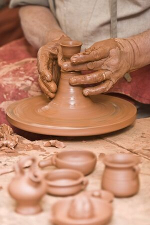 clay modeling: Potter working with clay. Stock Photo