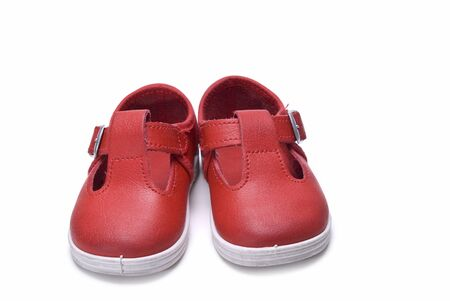 red shoes: Shoes for kids isolated over a white background.