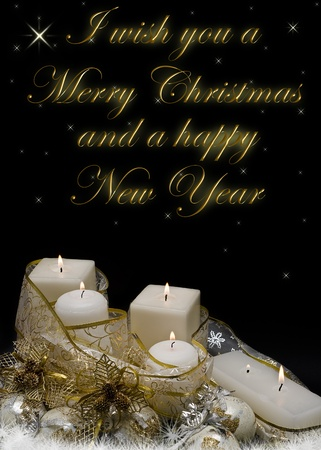 Christmas greeting card with candles, balls and golden garlands. photo