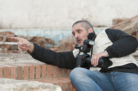 press agent: War photojournalist working in a dangerous environment.