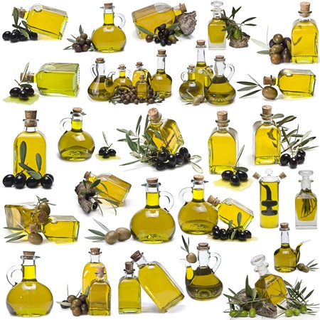 A large collection of olive oil bottles isolated on a white background. photo