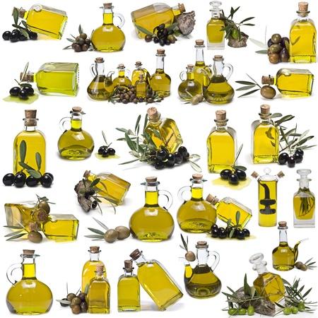 foglie ulivo: Una vasta raccolta di bottiglie di olio d'oliva isolato su uno sfondo bianco. Archivio Fotografico