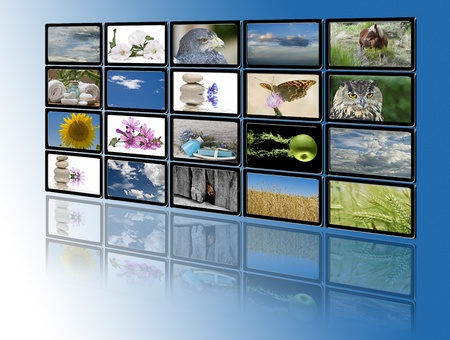 A group of monitors with images of nature and relaxing themes. photo
