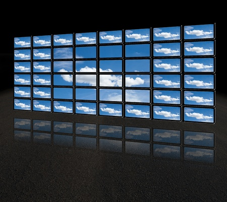 A group of flat screens with images about clouds in a futuristic style. photo