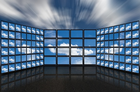 tv network: A group of flat screens with images about clouds in a futuristic style.