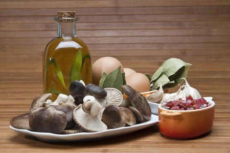 Mushrooms, eggs, ham and olive oil to cook a good menu. Stock Photo - 12379928