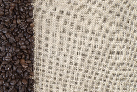 coffe beans: Background of burlap and coffee beans with a copy space. Stock Photo