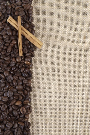 coffe beans: Background of burlap and coffee beans with a copy space