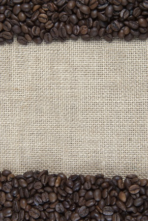 Background of burlap and coffee beans with a copy space  photo