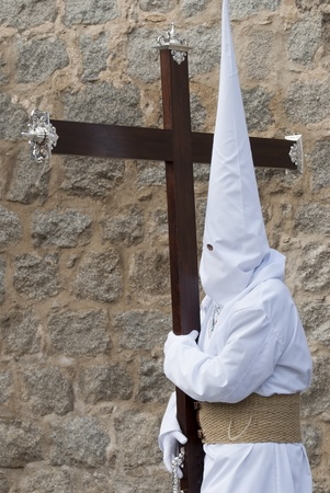 Easter nazarene in white robe in a typical Spanish procession.  photo