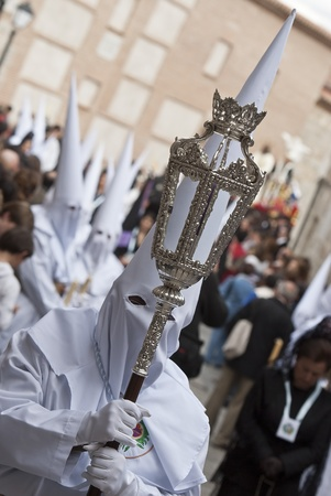 procession: Easter nazarenes in white robe in a typical Spanish procession