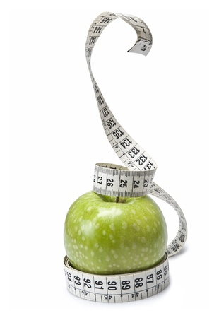Tape measure simulating a snake wrapped around an apple. photo