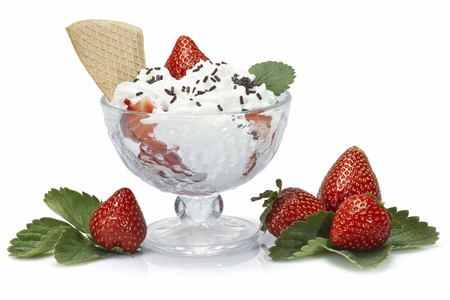 cream and green: Strawberries and whipped cream cup isolated over a white background