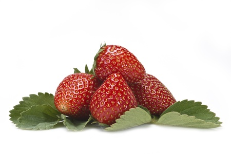 Strawberries with their leaves isolated on a white background photo