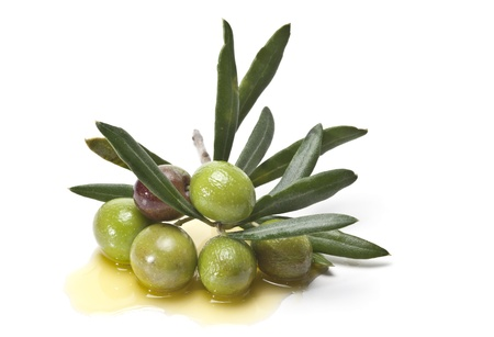 Olives covered in oil over a white basckground.