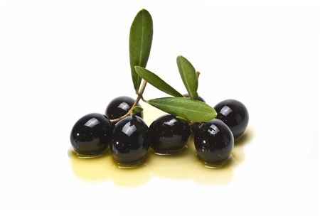 Olives covered in oil over a white background