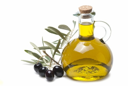 A jar with olive oil and some black olives isolated over a white background  photo