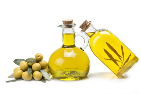 Jars with olive oil and some olives isolated over a white background