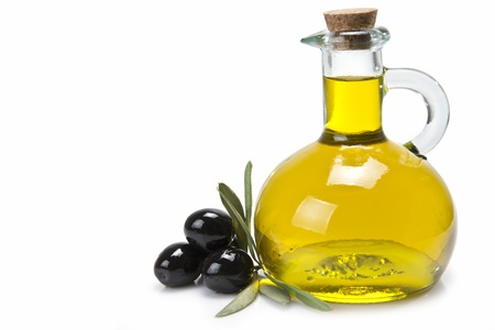 olive oil bottle: A jar with olive oil and some black olives isolated over a white background