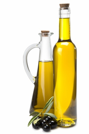 carafe: Jars with olive oil and some olives isolated over a white background