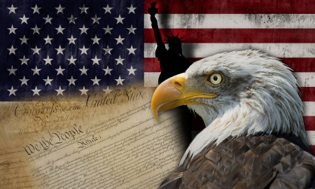Bald eagle and the silhouette of the statue of liberty with some historical documents on the american flag 写真素材