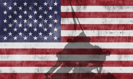 Marine Corps War Memorial monument againts the american flag