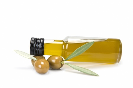 kalamata: Glass bottle of premium virgin olive oil and some olives with leaves isolated on a white background
