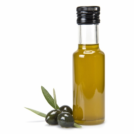 Glass bottle of premium virgin olive oil and some olives with leaves isolated on a white background photo