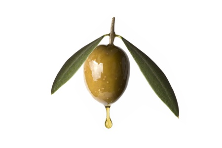 A drop of olive oil falling from one green olive isolated on a white background