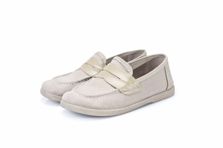 children's wear: Beige shoes for kids isolated on a white background