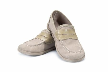 moccasins: Beige shoes for kids isolated on a white background