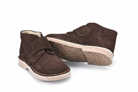 children's wear: Brown leather boots for kids isolated on a white background.