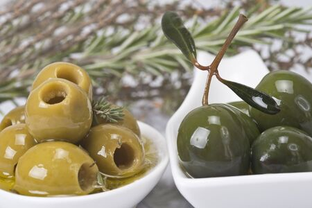 Pitted olives in a saucer isolated on a white background. photo