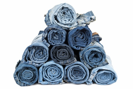 Rolled jeans arranged in a pyramid and isolated over a white background Standard-Bild