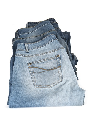 bluejeans: Three old and worn blue jeans isolated over a white background Stock Photo